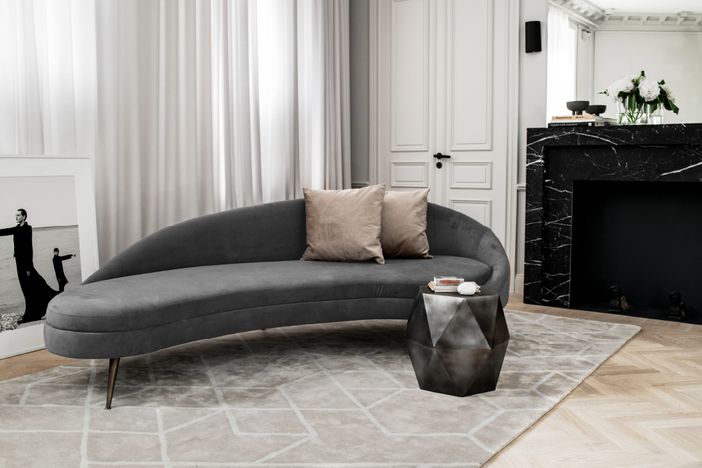 Layered gray velvet kidney sofa in modern home