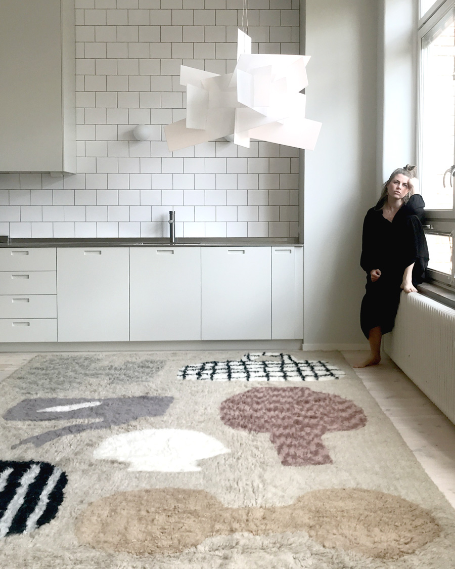 emilia ilke with her patterned rug for layered
